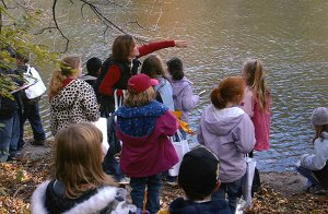 school children at water's edge
